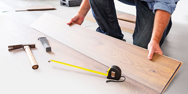 Measuring a piece of wood for home renovations