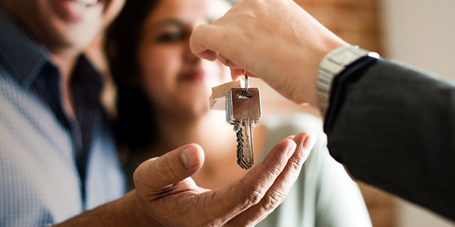 Couple gets keys to their new home